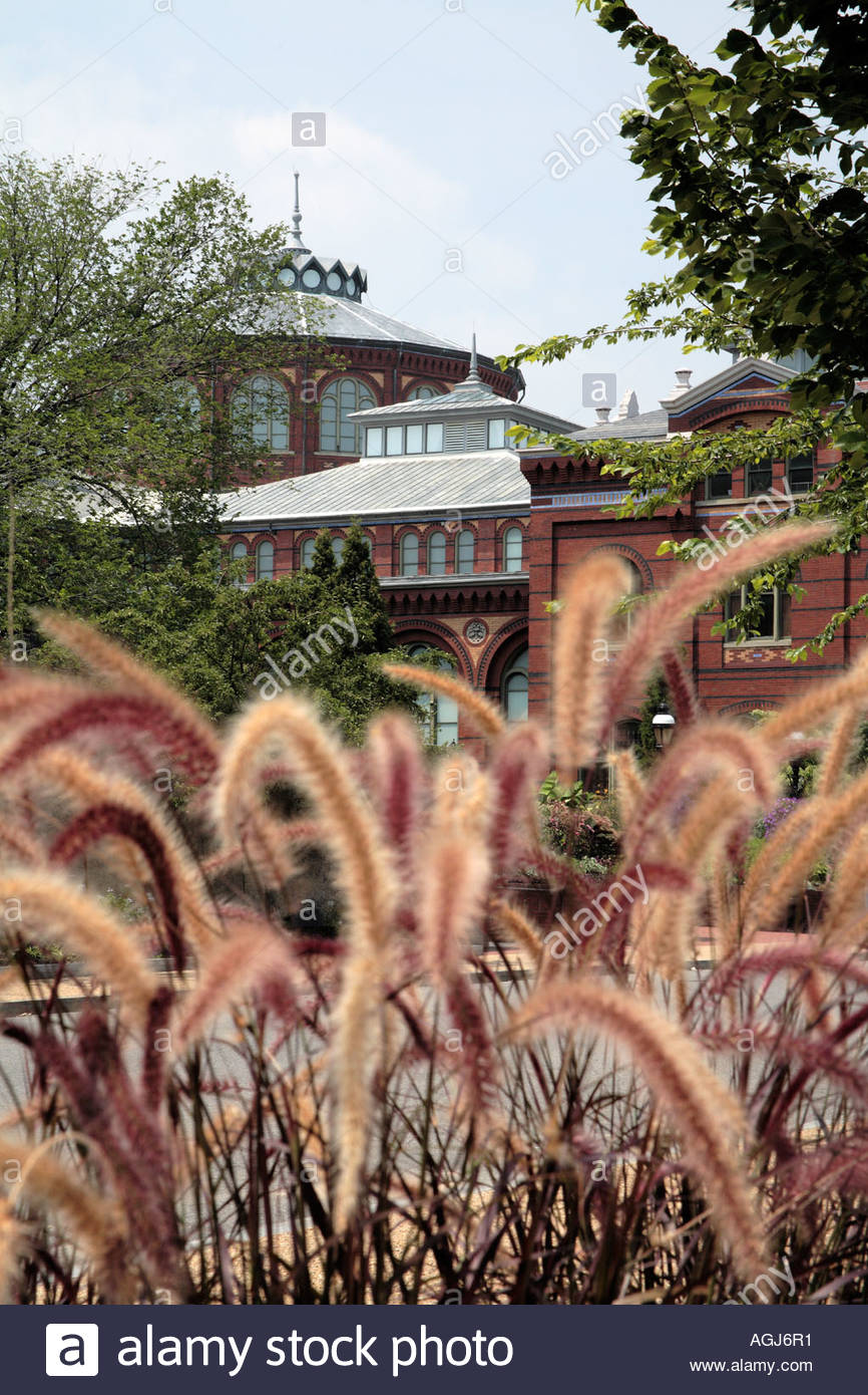 View of the Smithsonian Institution Arts and Industries Building through ornamental grass in Washington DC - Stock Image