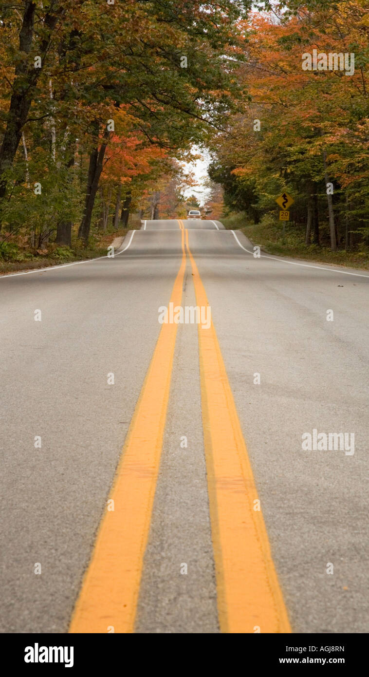 Stretch of road just west of the ferry landing that services Washington Island (Door County)  with fall colors in - Stock Image