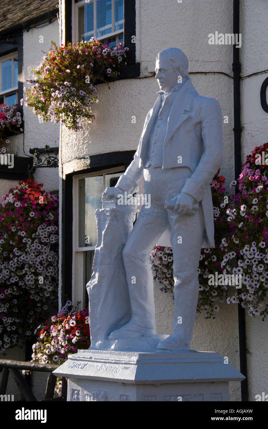 Clovenfords Hotel inn near Galashiels Scottish Borders with statue of famous visitor Sir Walter Scott - Stock Image