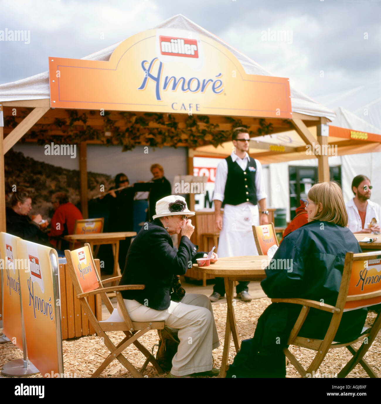People enjoying yoghurt at the Muller Amore Cafe at the 2006 Guardian Hay Festival Hay-on-Wye, Wales UK - Stock Image