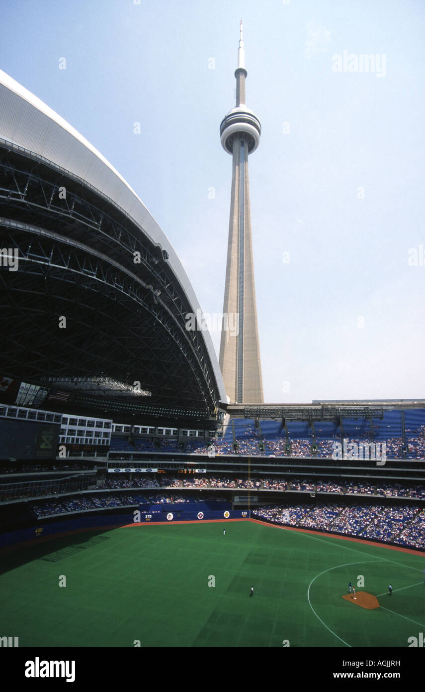 CN tower in Toronto,the World's second tallest building,at a staggering 1815ft.5inches dominating the  Skydome - Stock Image