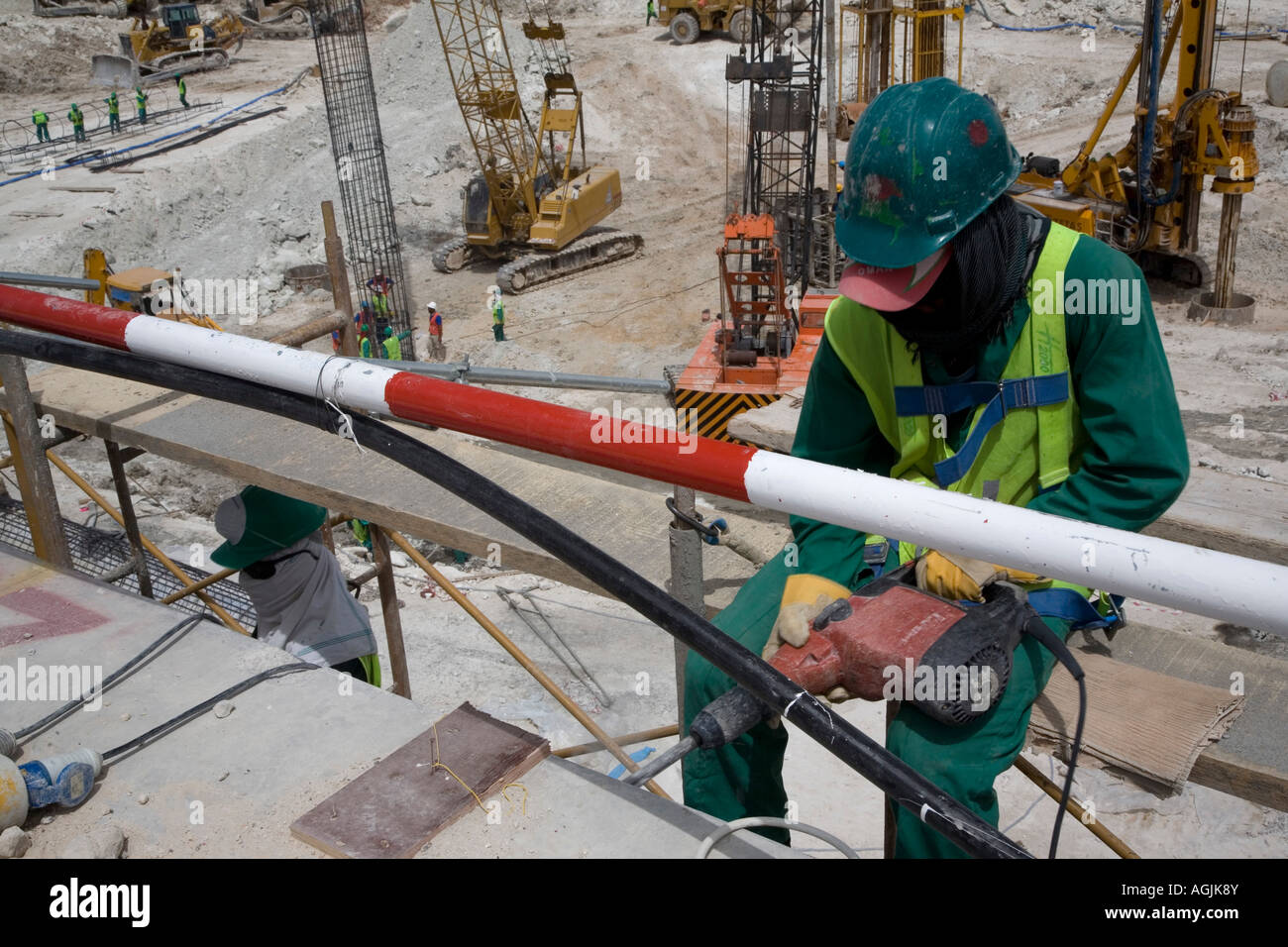 worker preparing for concrete rebar filling by drilling into