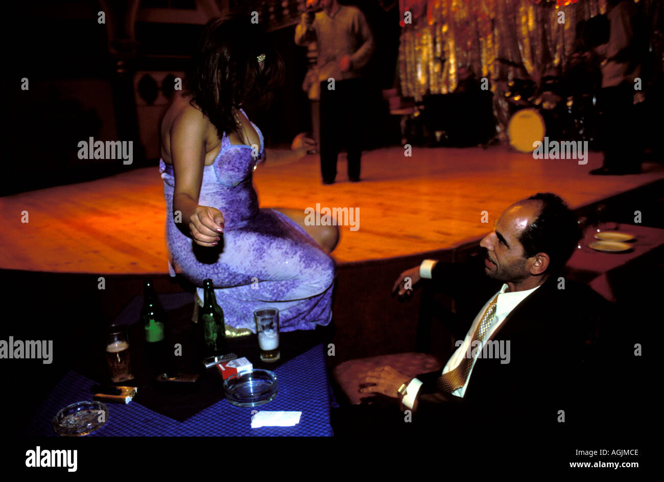 Cairo Belly Dancer In A Nightclub Dancing On The Table Of A Customer