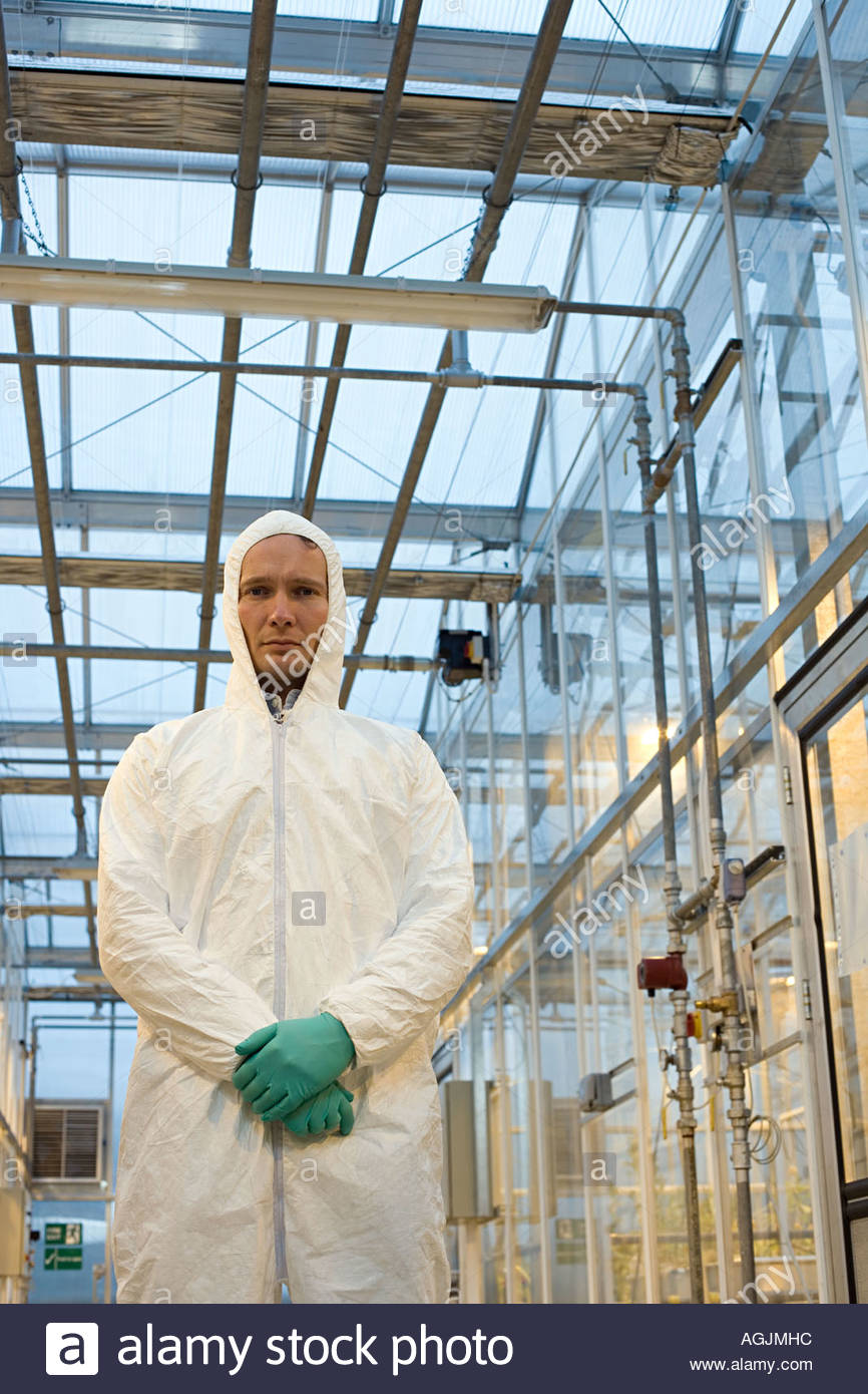 Scientist in protective suit - Stock Image