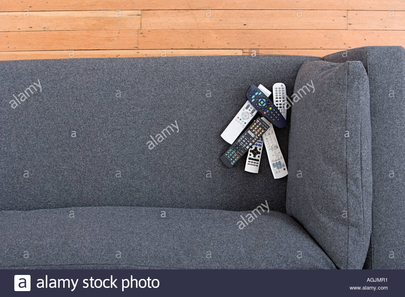 Remote controls on a sofa - Stock Image