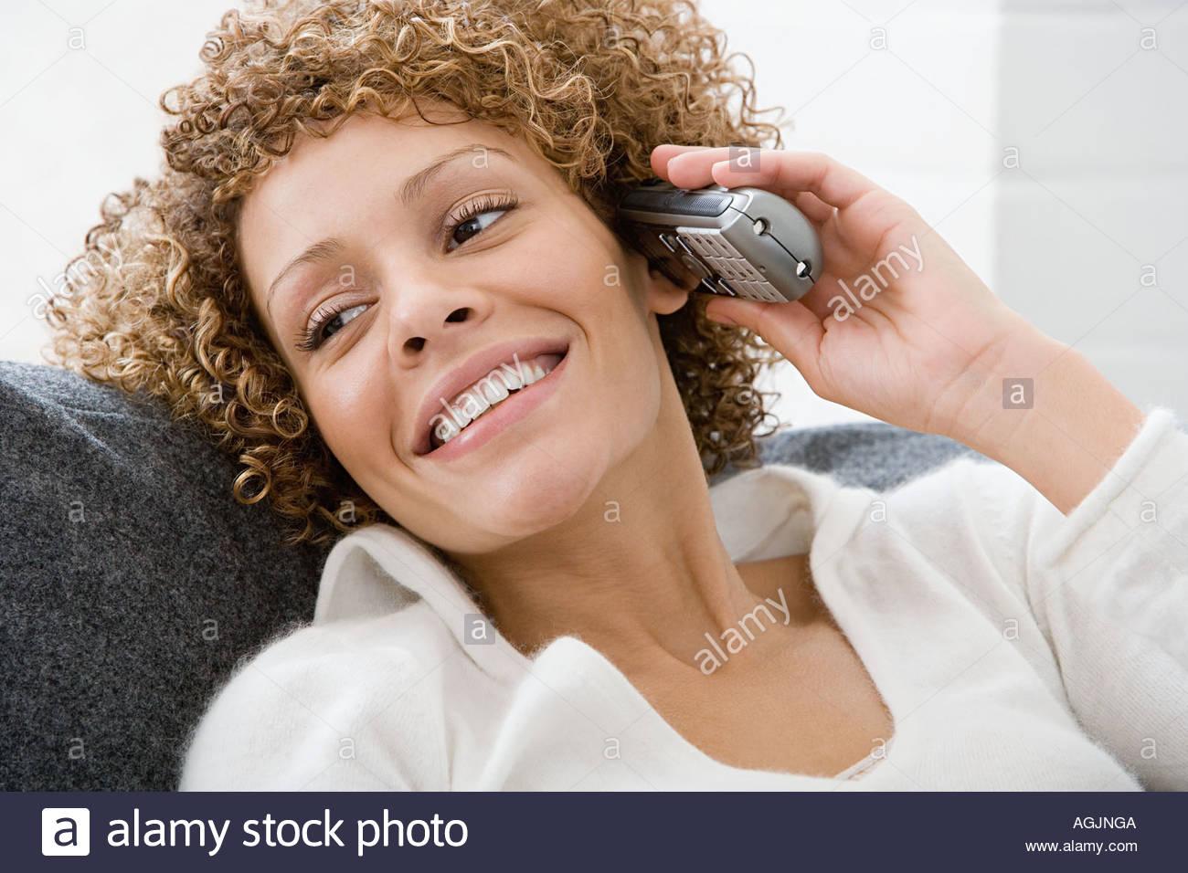 Woman on cordless telephone - Stock Image