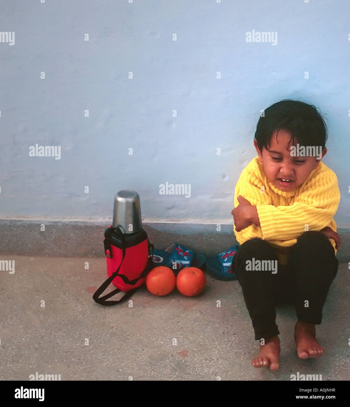 Painet jm7688 indian india kid young school girl child sitting sad unhappy angry water bottle waterbottle oranges - Stock Image