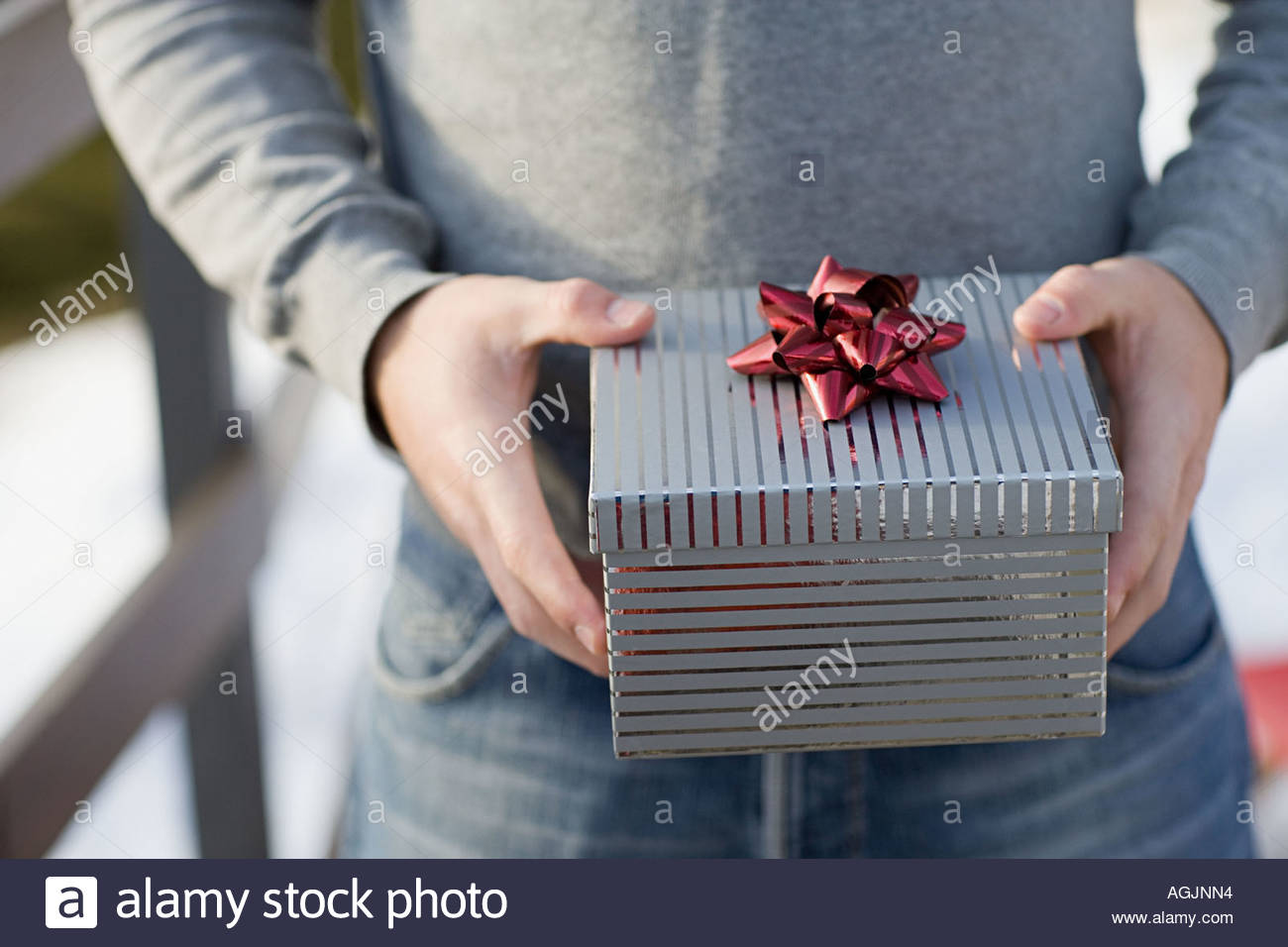 Man holding a gift - Stock Image