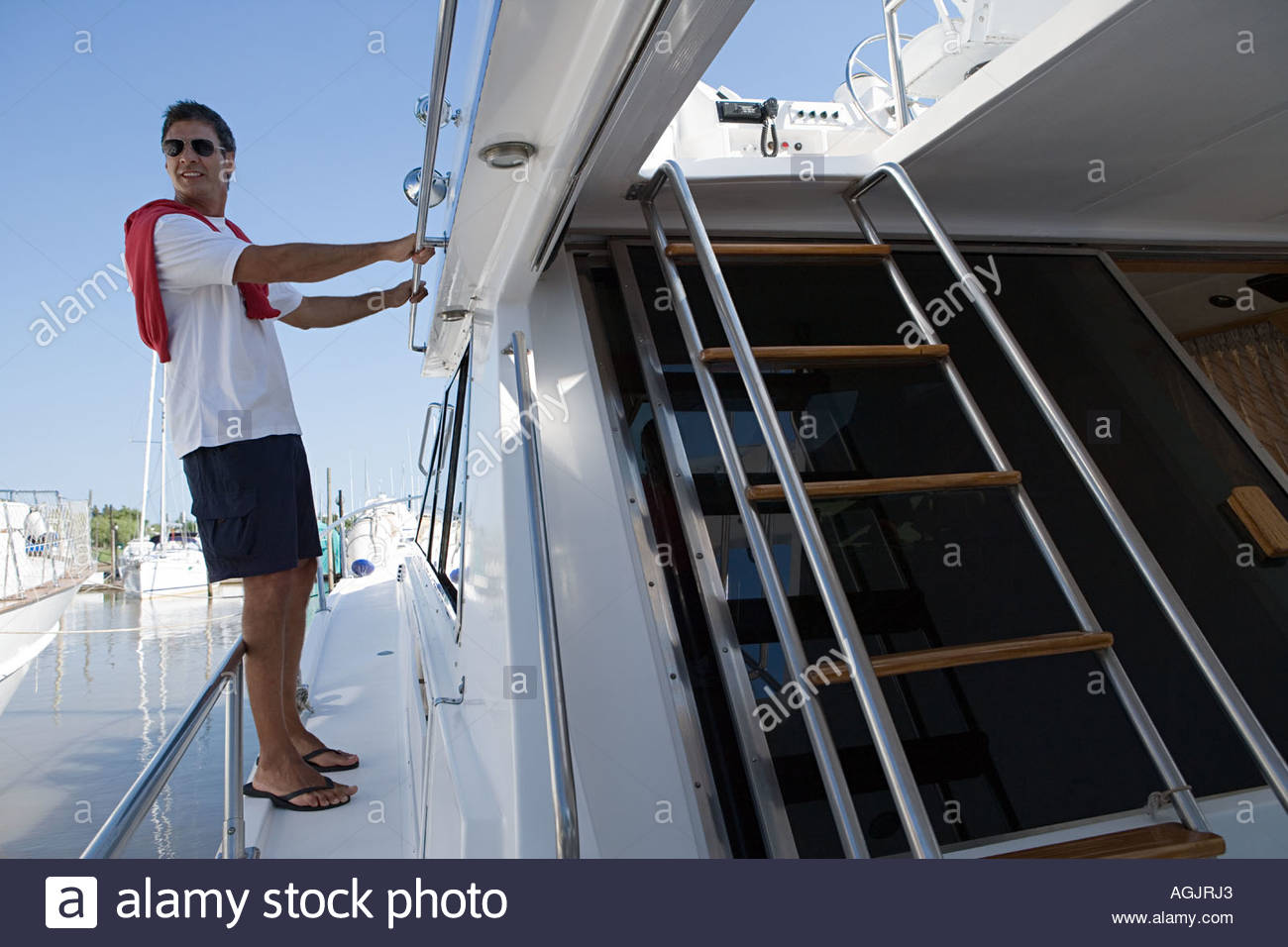 Man on a yacht - Stock Image