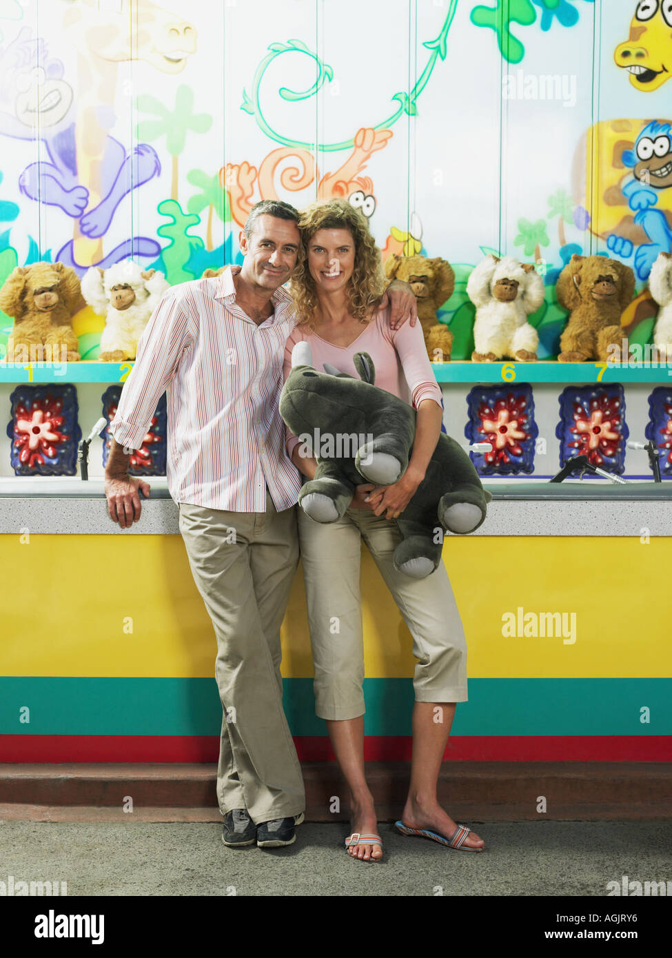 Couple by fairground stall Stock Photo