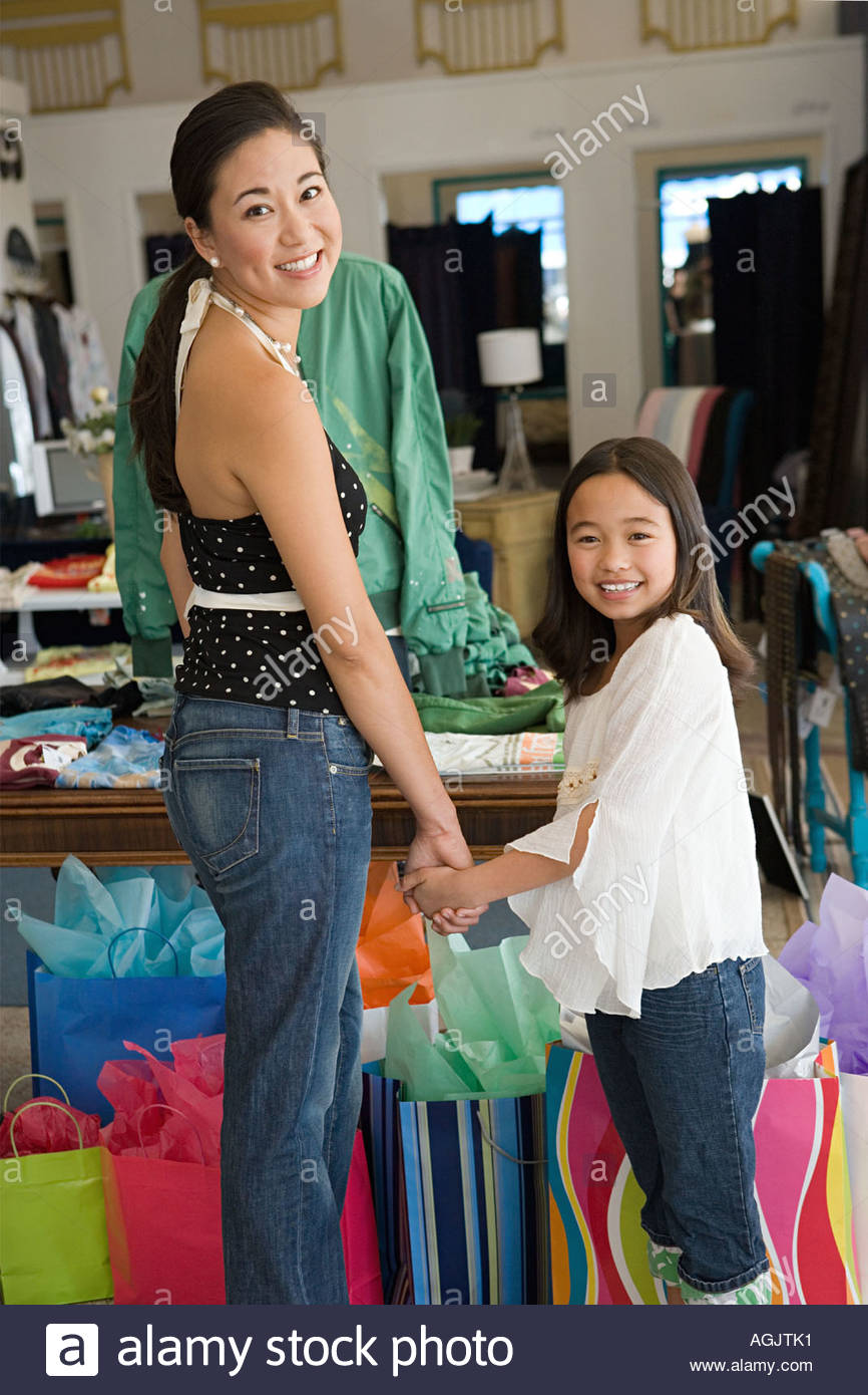 Mother and daughter in clothes shop - Stock Image