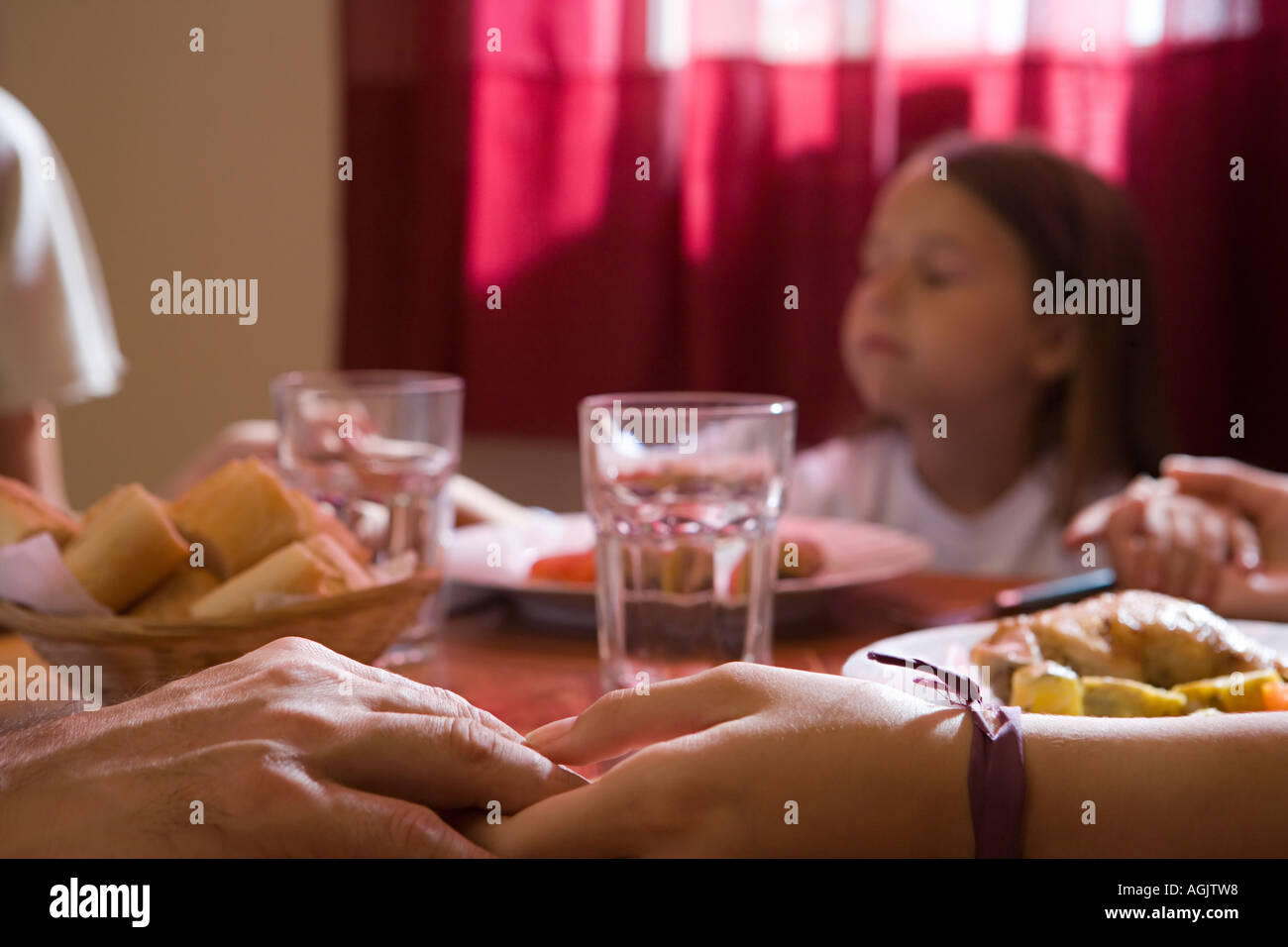 Family saying grace - Stock Image