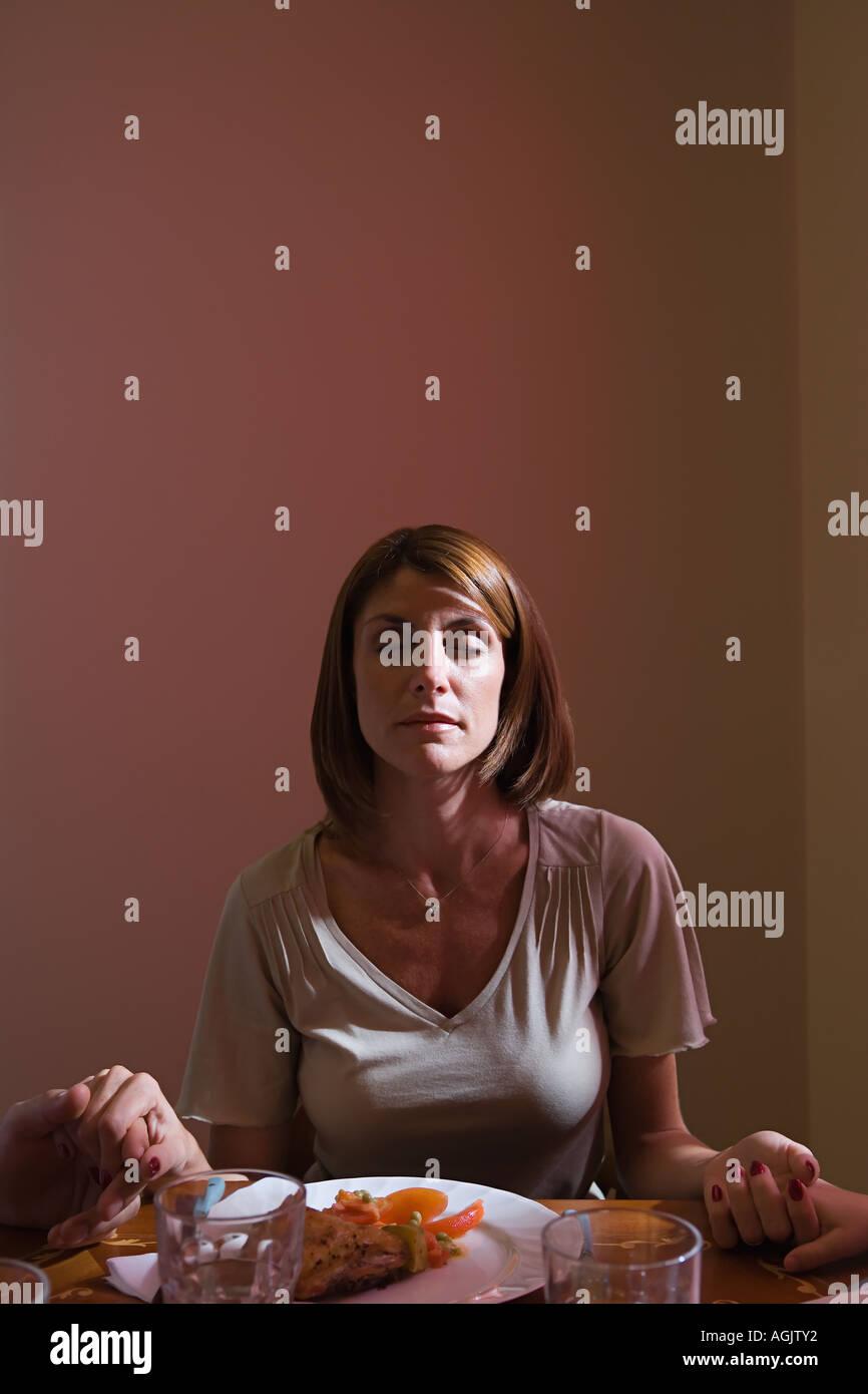 Woman saying grace - Stock Image