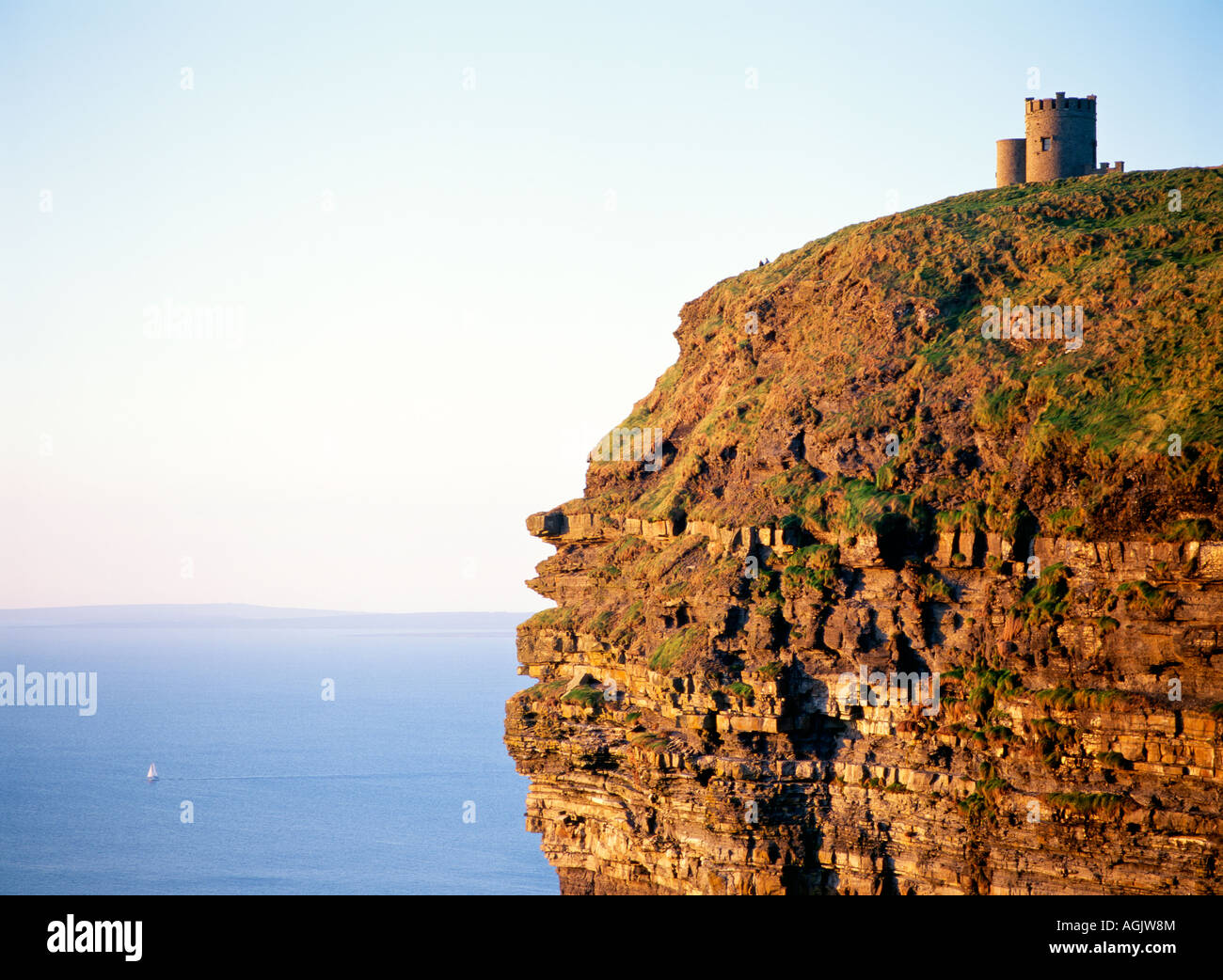 O'Briens Tower on top of the sheer Cliffs of Moher, County Clare, west Ireland. Sailboat yacht in distance. Atlantic - Stock Image