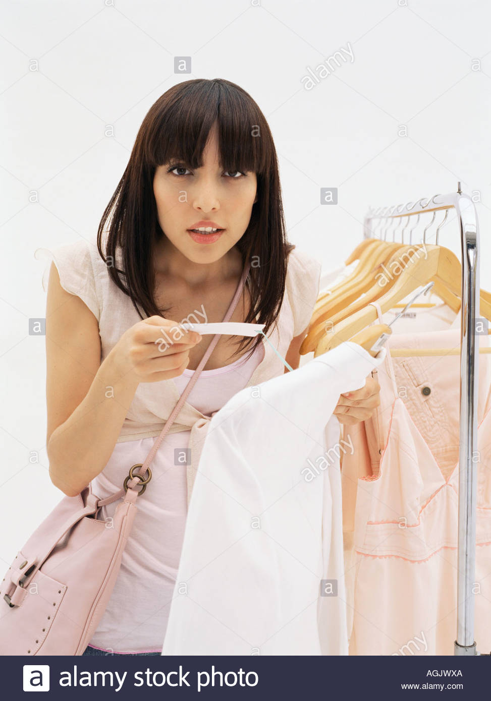 Woman holding price label - Stock Image
