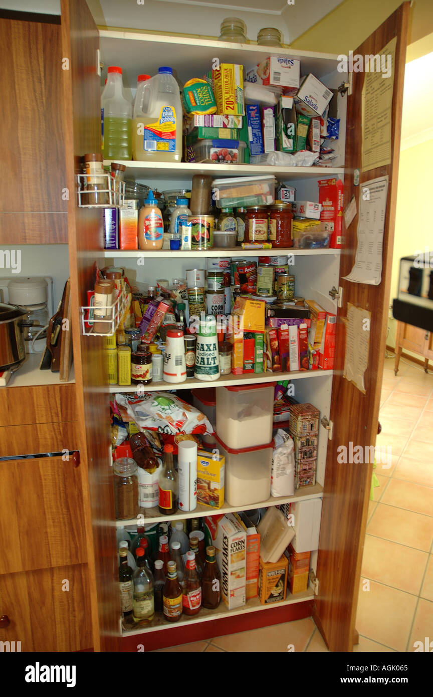 Over stocked larder in country home with teenagers dsc 0831 - Stock Image
