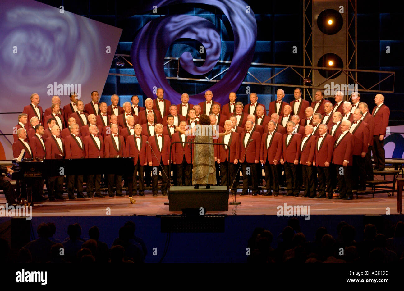 Male voice choir singing on stage at the National Eisteddfod of Wales in Newport South Wales UK - Stock Image