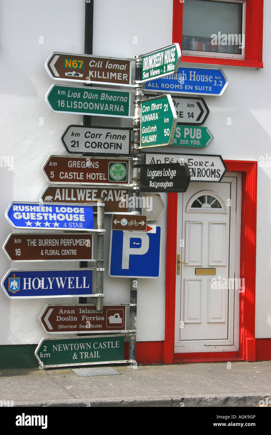 multitude of direction signs in Ballyvaughan, County Clare, Ireland - Stock Image