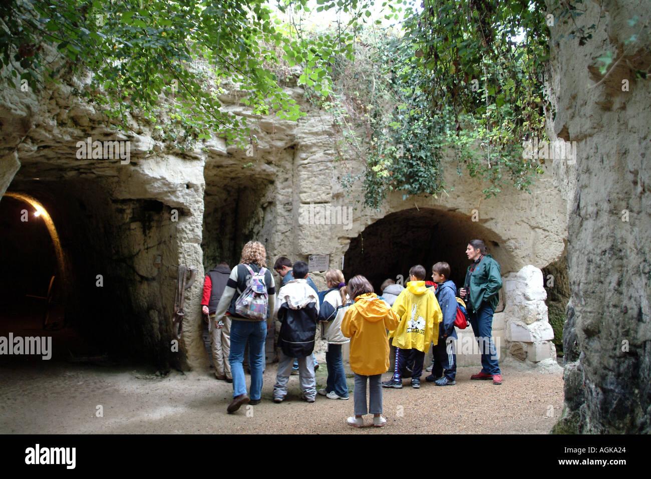 Troglodytes underground home built into caves at La Fosse near Saumur France EU school children visit - Stock Image