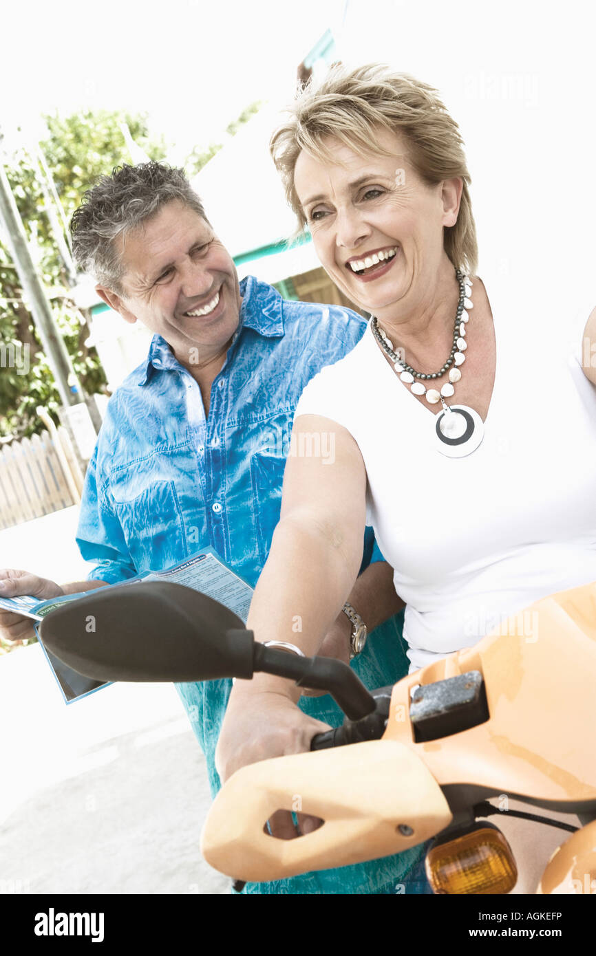 Close-up of a senior man and a mature woman smiling - Stock Image
