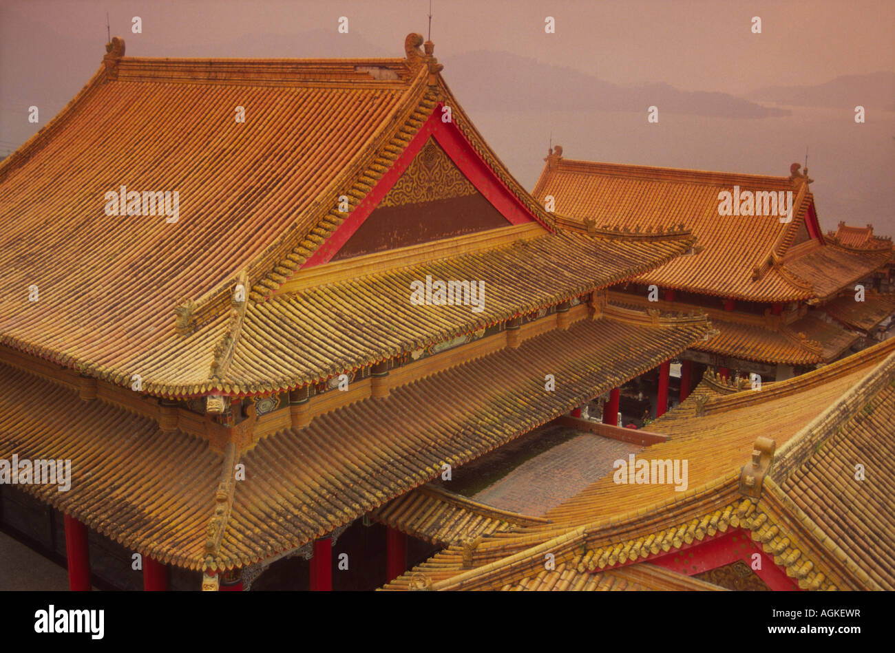 Taiwan, Wenwu Temple rooftops with Sun Moon Lake in background. - Stock Image