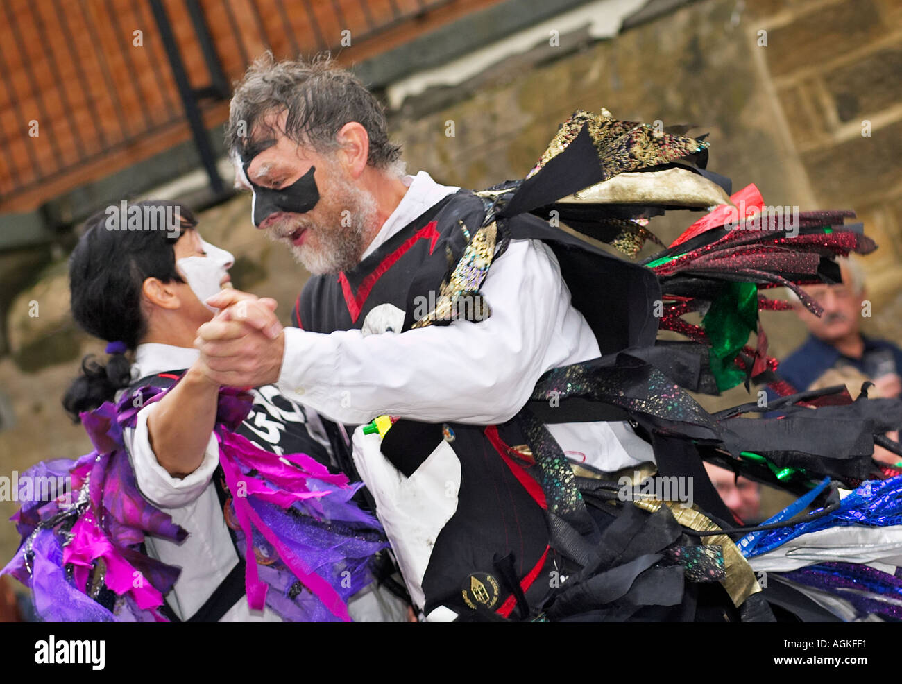 Morris man and woman couple morris dancing together at a Folk Festival Yorkshire England UK - Stock Image