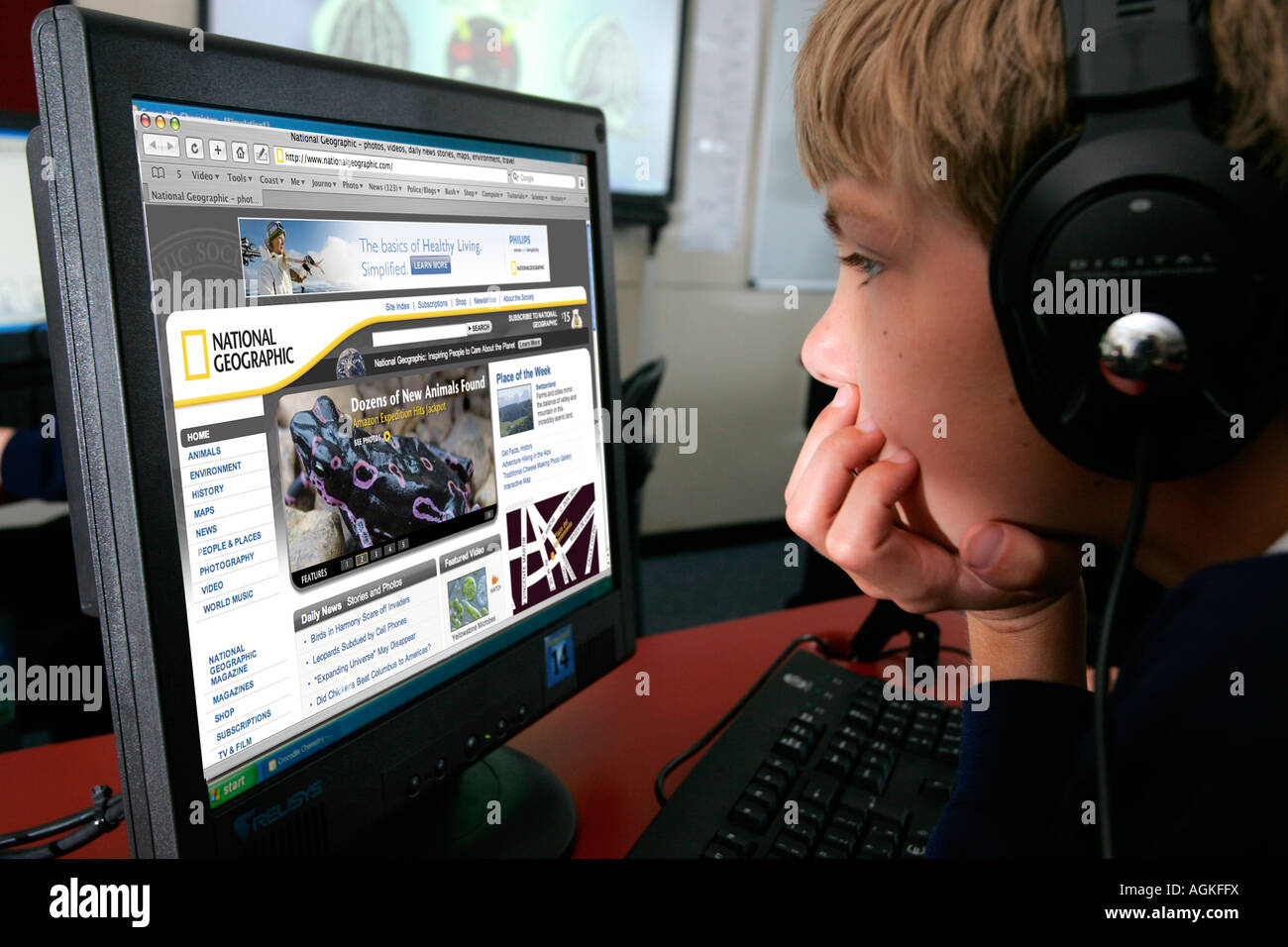 Primary school boy looking National Geographic website on computer. South of England UK Great Britain EDITORIAL - Stock Image