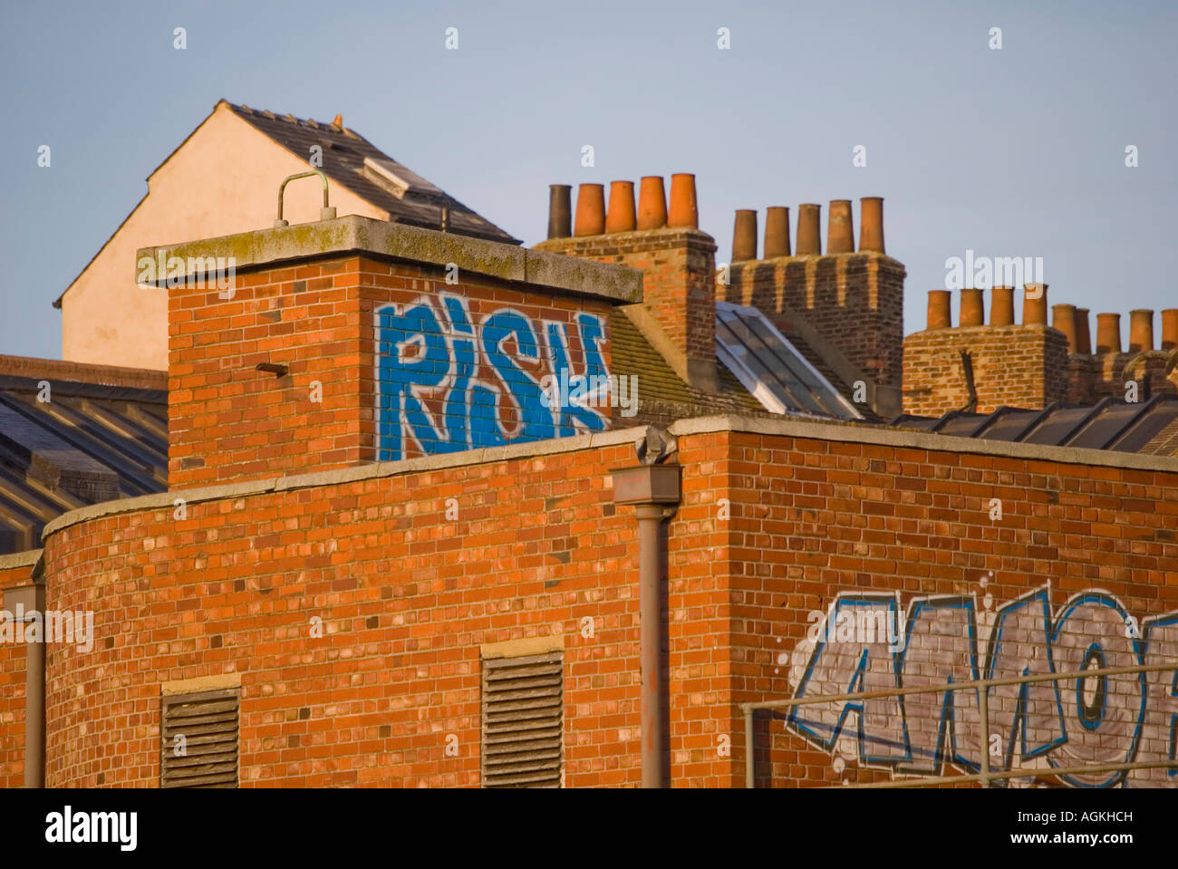 rooftops with graffitti on walls - Stock Image