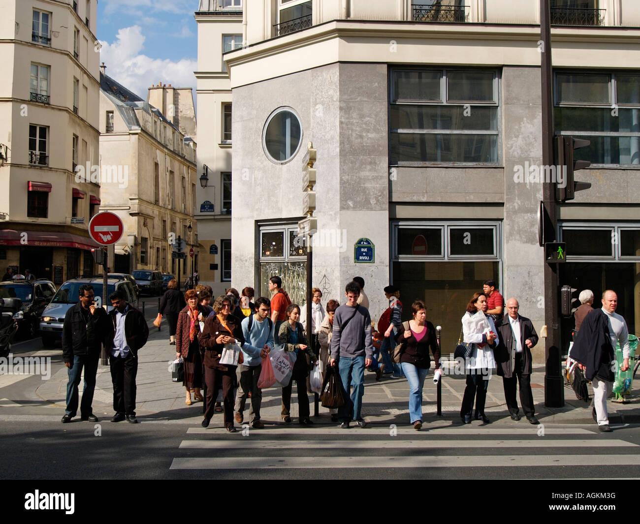 Collection of average Parisians crossing the street Rue de Rivoli Paris France - Stock Image
