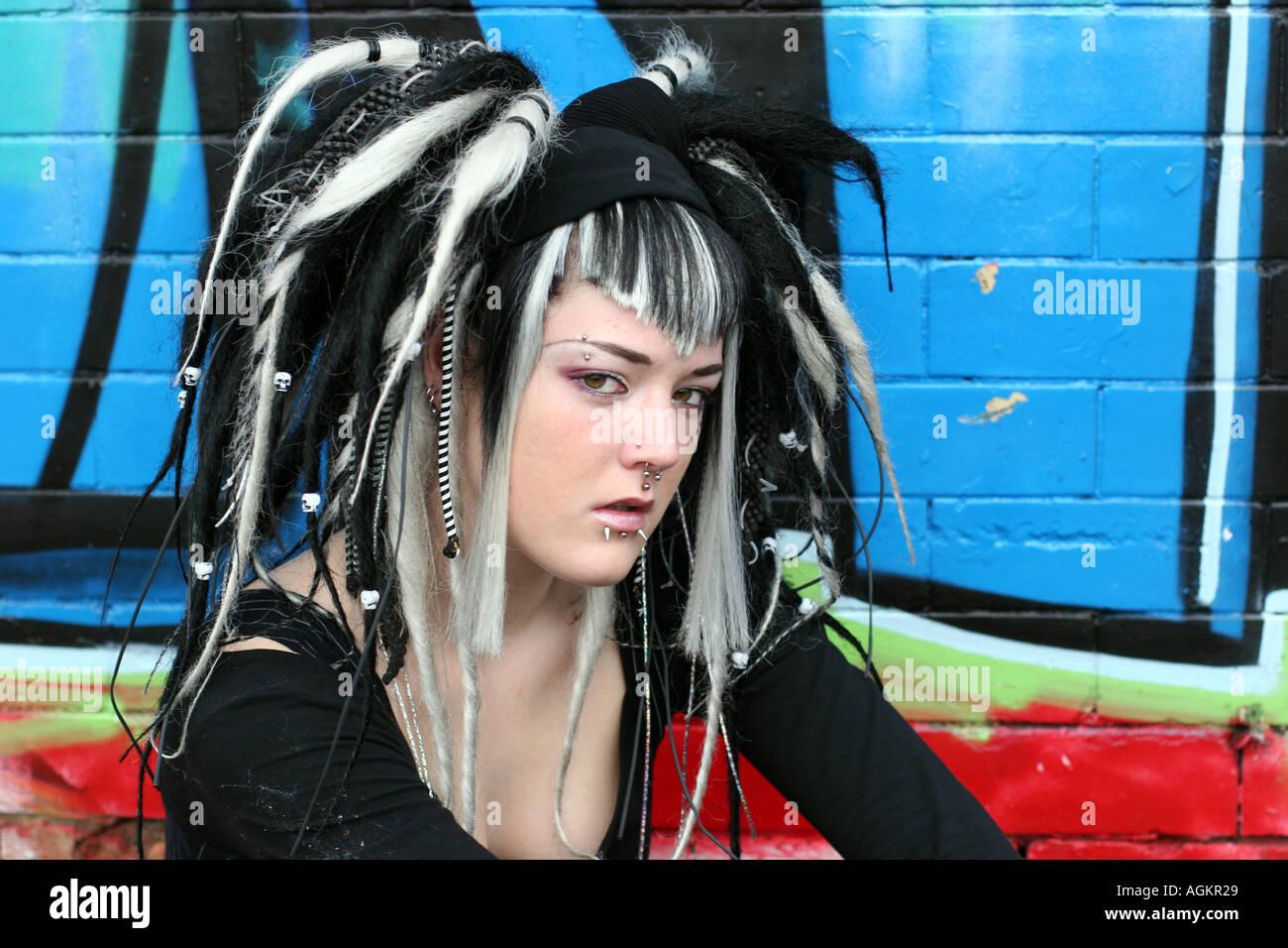 gothic girl posing in grafitti wall - Stock Image