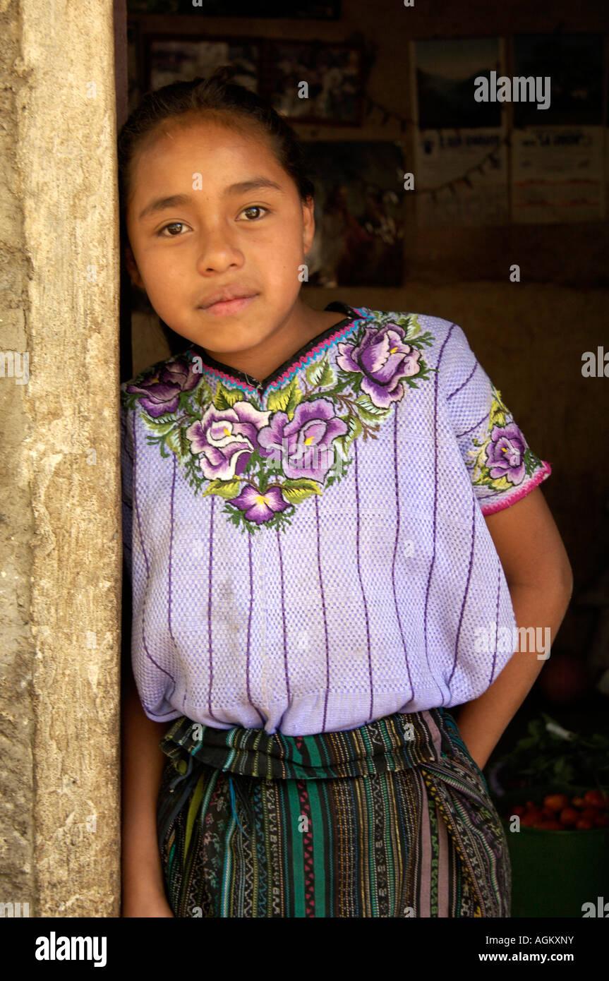 Guatemala, Santiago Atitlan, Portrait of girl in doorway. - Stock Image