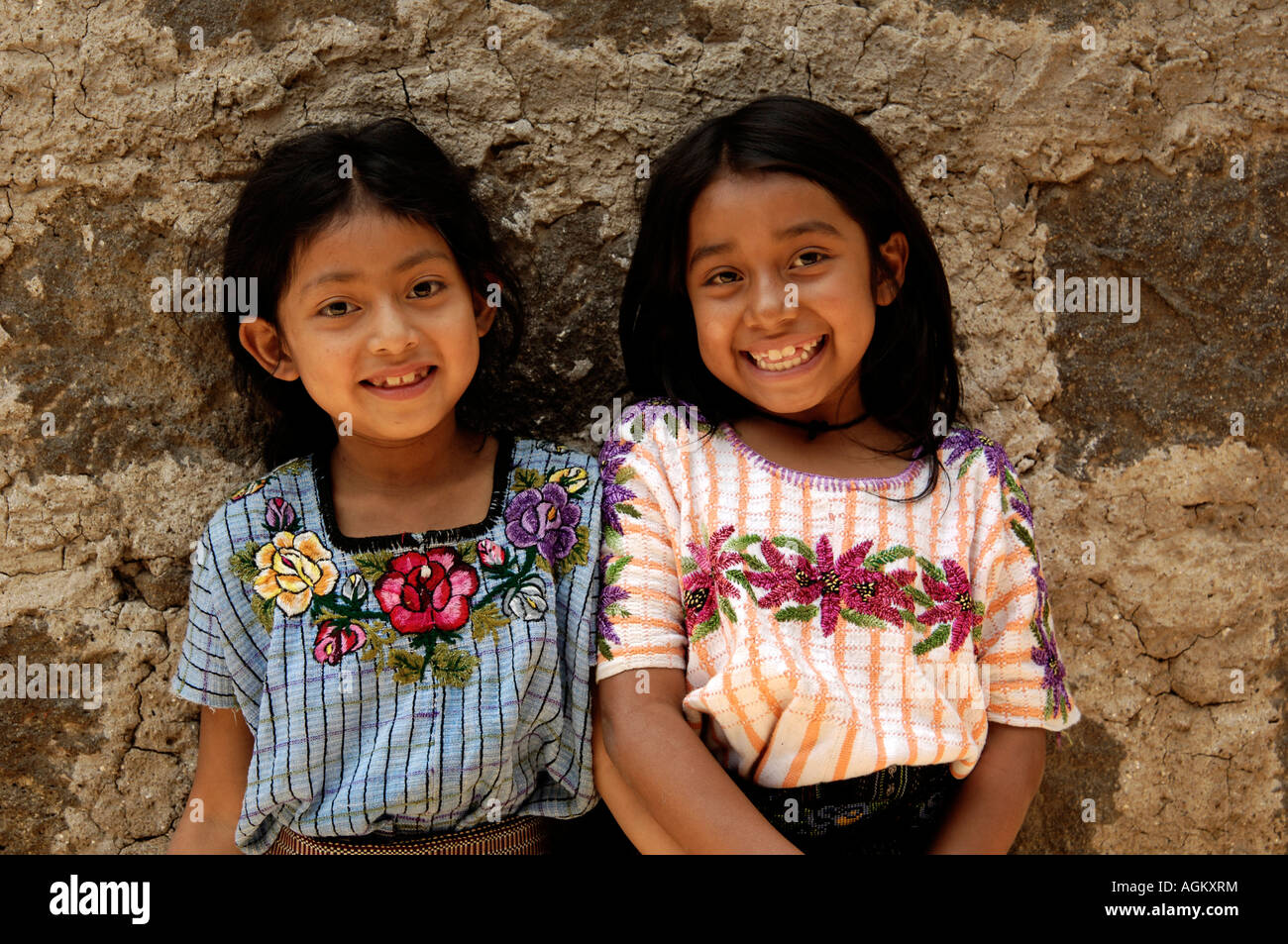 Guatemala, Santiago Atitlan, Portrait of two smiling girls. - Stock Image