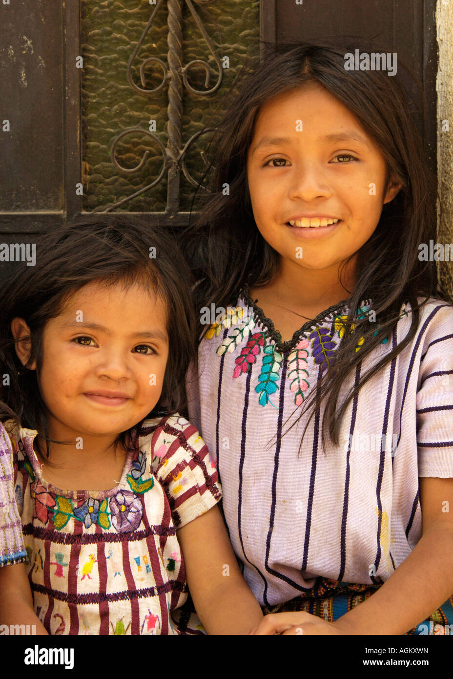 Guatemala, Santiago Atitlan, Portrait of older and younger sisters. - Stock Image