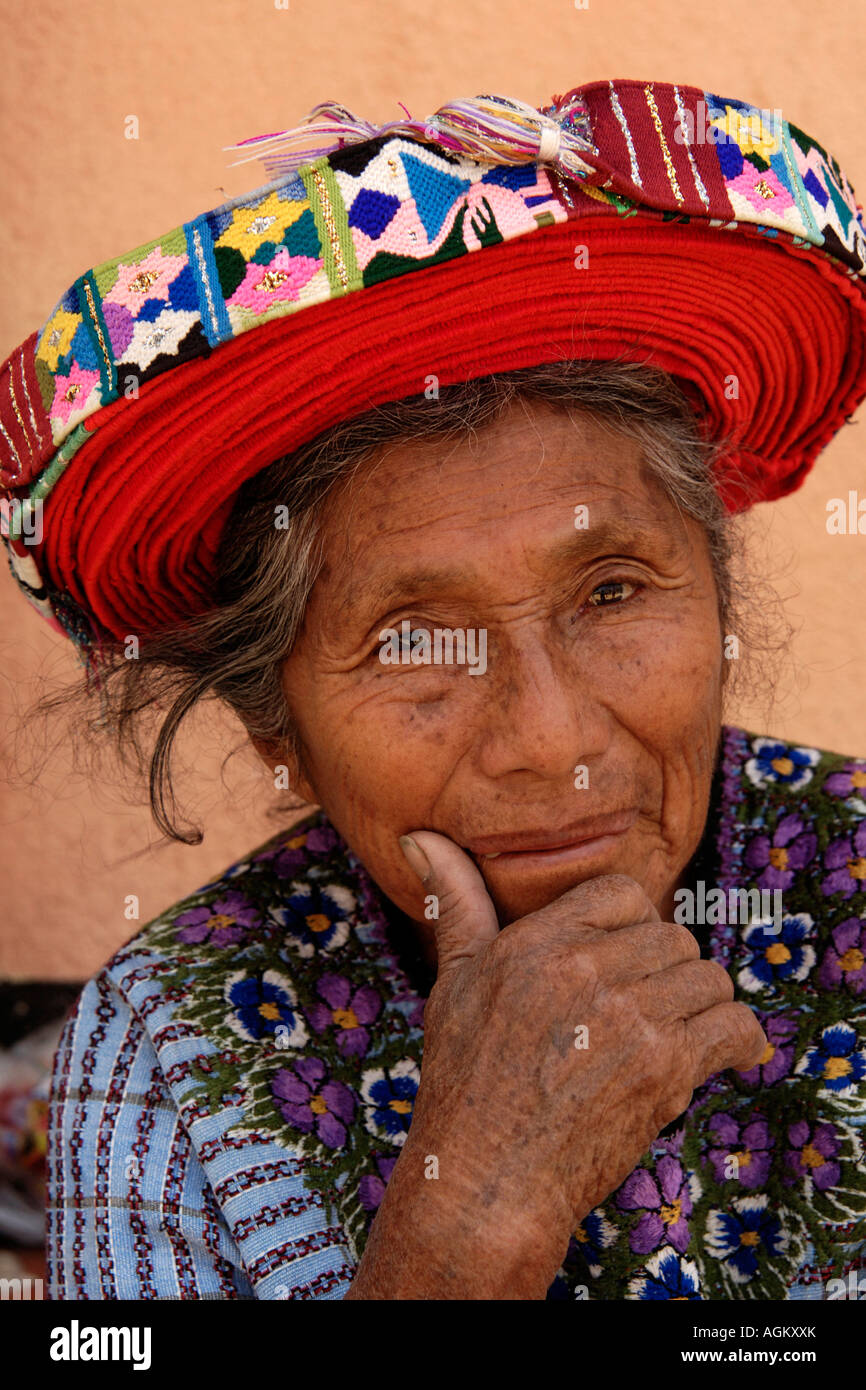 Guatemala, Santiago Atitlan, Portrait of pensive elderly woman with colorful hat. - Stock Image