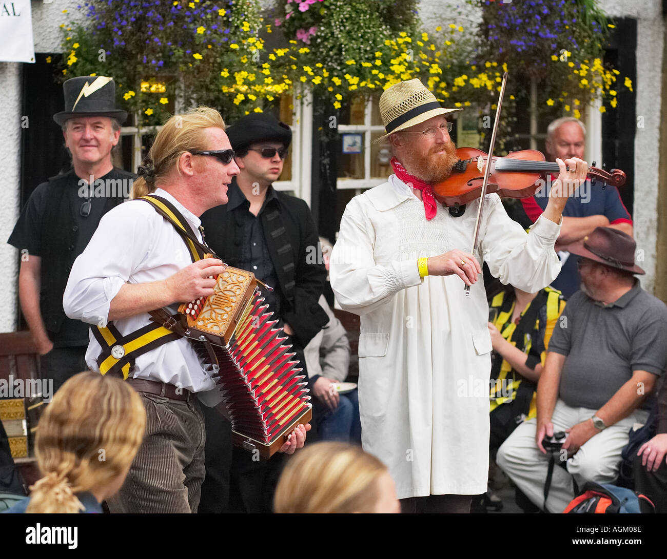 Musicians dressed in traditional costume play for the morris dancers at a Folk Festival in Yorkshire, England, UK - Stock Image