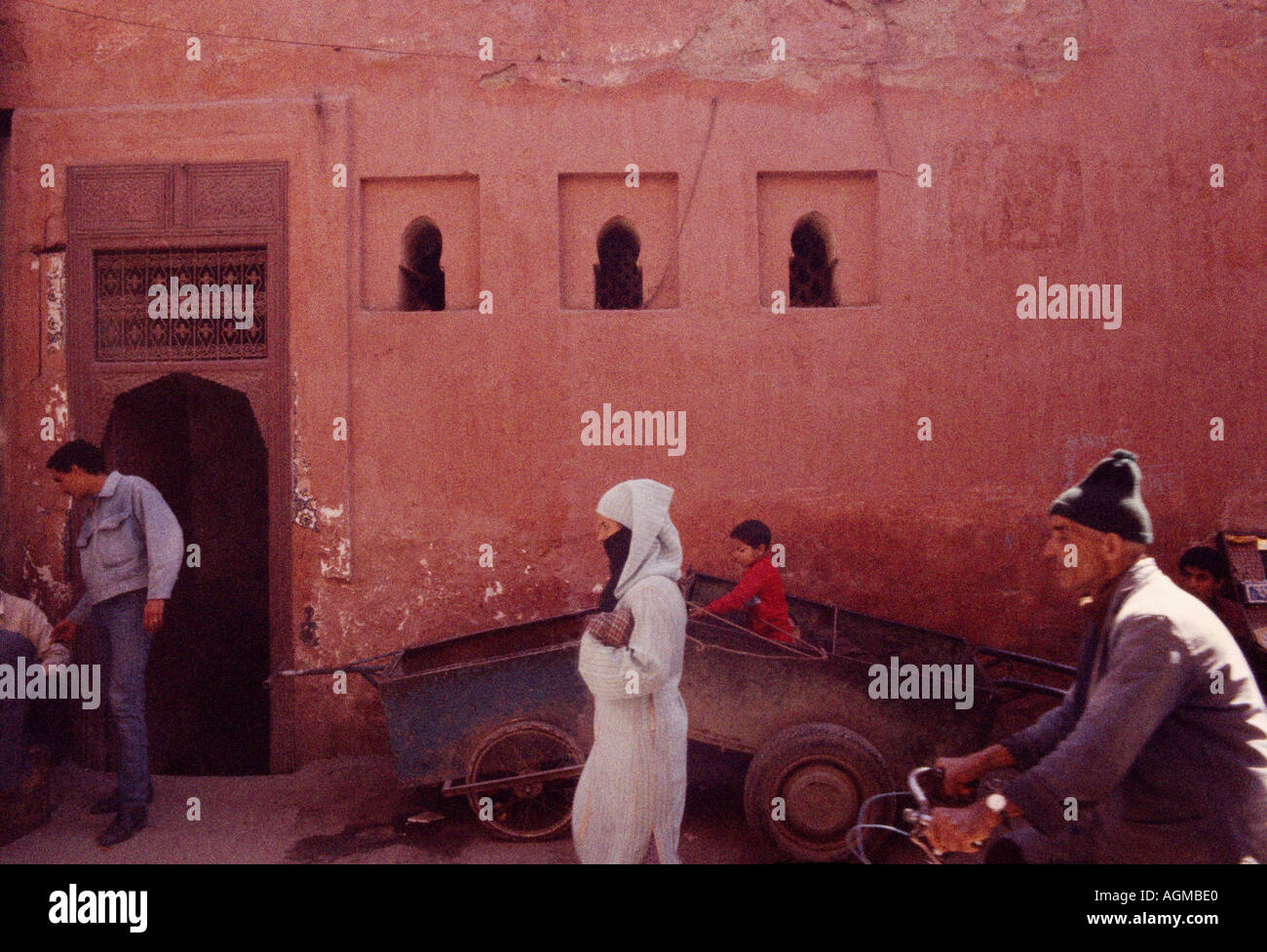 Moroccan people in a street scene in Marrakech Marrakesh in Morocco in the Maghreb in North Africa Sahara. Moorish Life Lifestyle Travel - Stock Image
