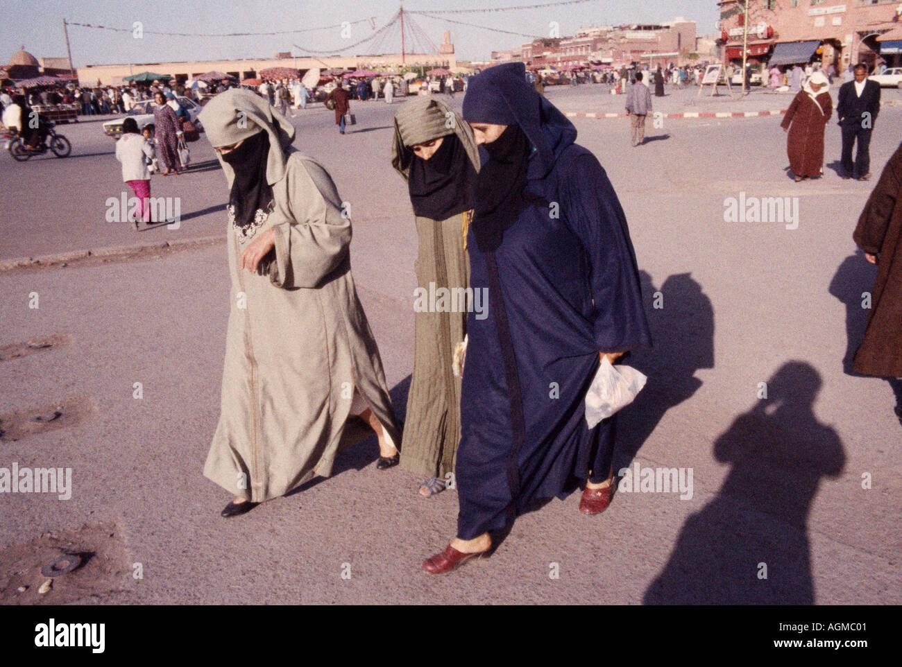 Yahmak veiled women in Djemma El Fna in Marrakech Marrakesh in Morocco in the Maghreb in North Africa Sahara. Reportage Moroccan People Moorish - Stock Image
