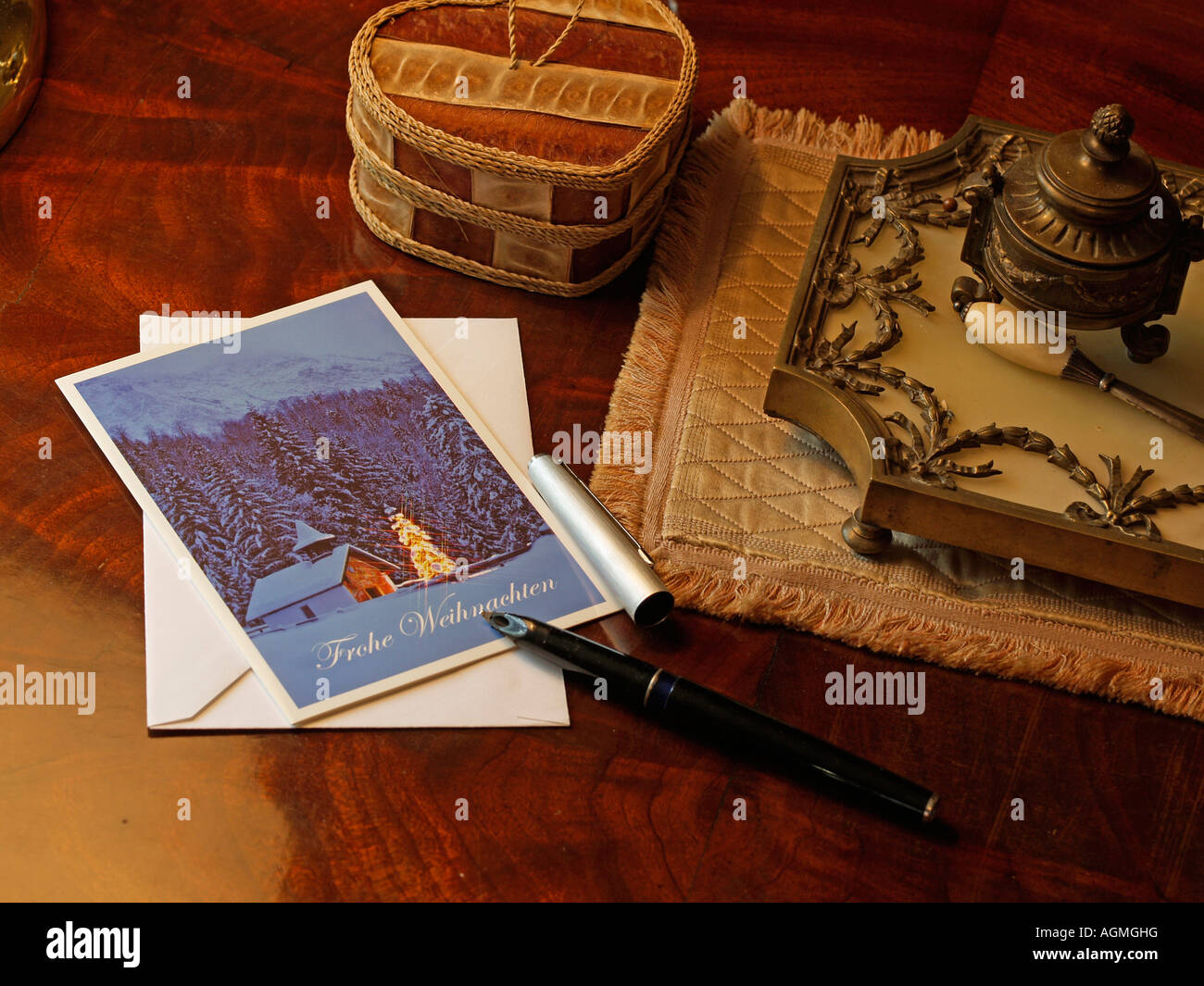 Christmas greetings cards stock photos christmas greetings cards writing a christmas greetings cards fountain pen on a christmas card on a desk stock m4hsunfo