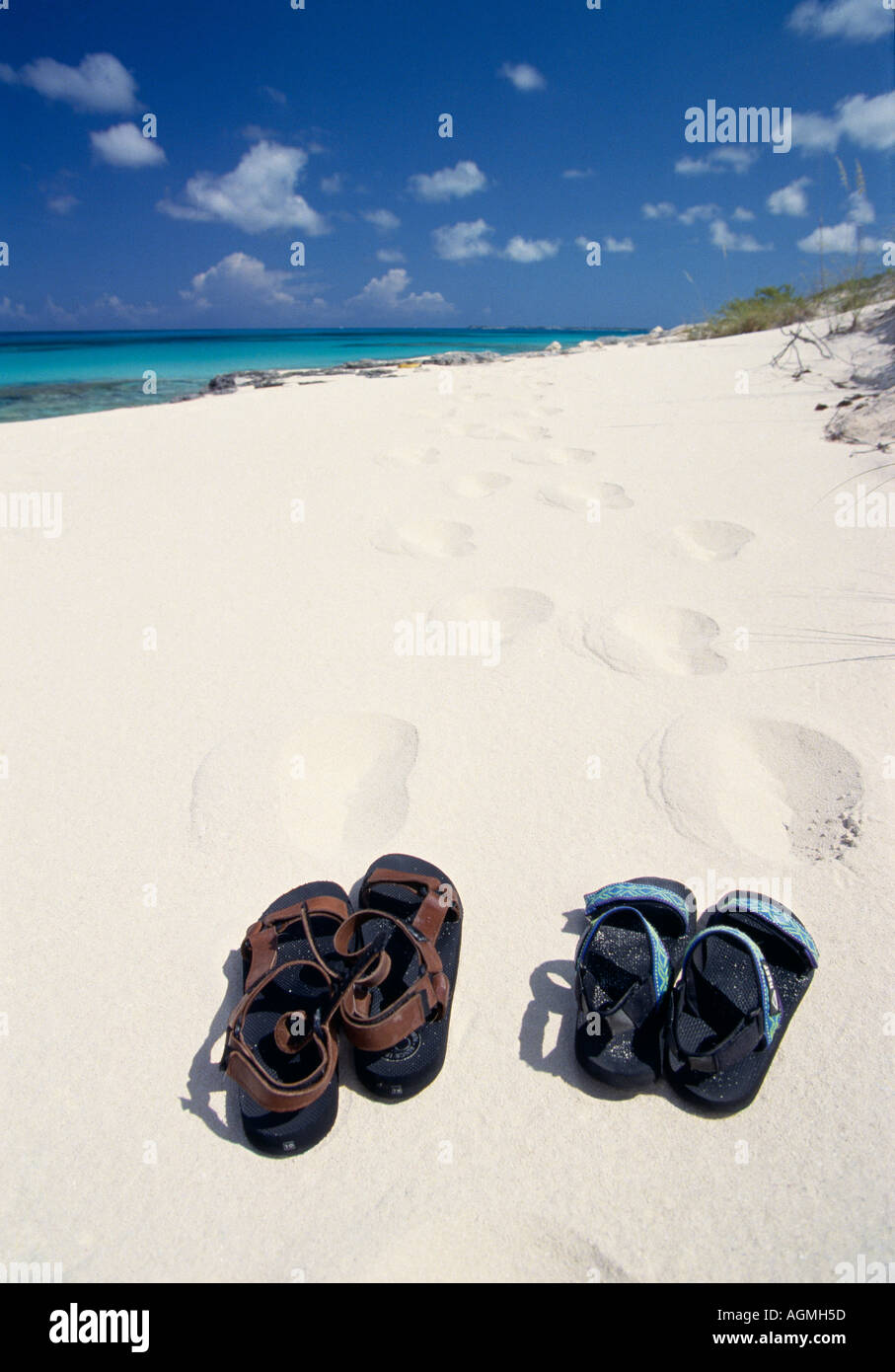 83458a10e San Salvador Club Med Columbus Isle Two pairs of sandals left on the white  sand beach