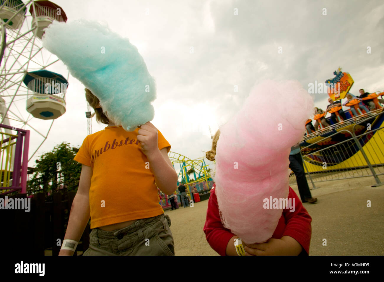 Children eating candyfloss at the funfair - Stock Image