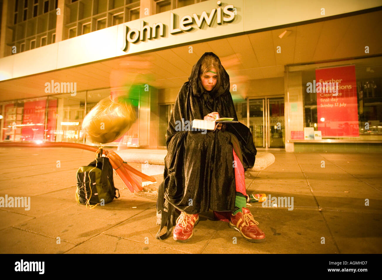 Launch Harry Potter book 1am Oxford Street London Young Woman reads the first few pages outside John Lewis department - Stock Image