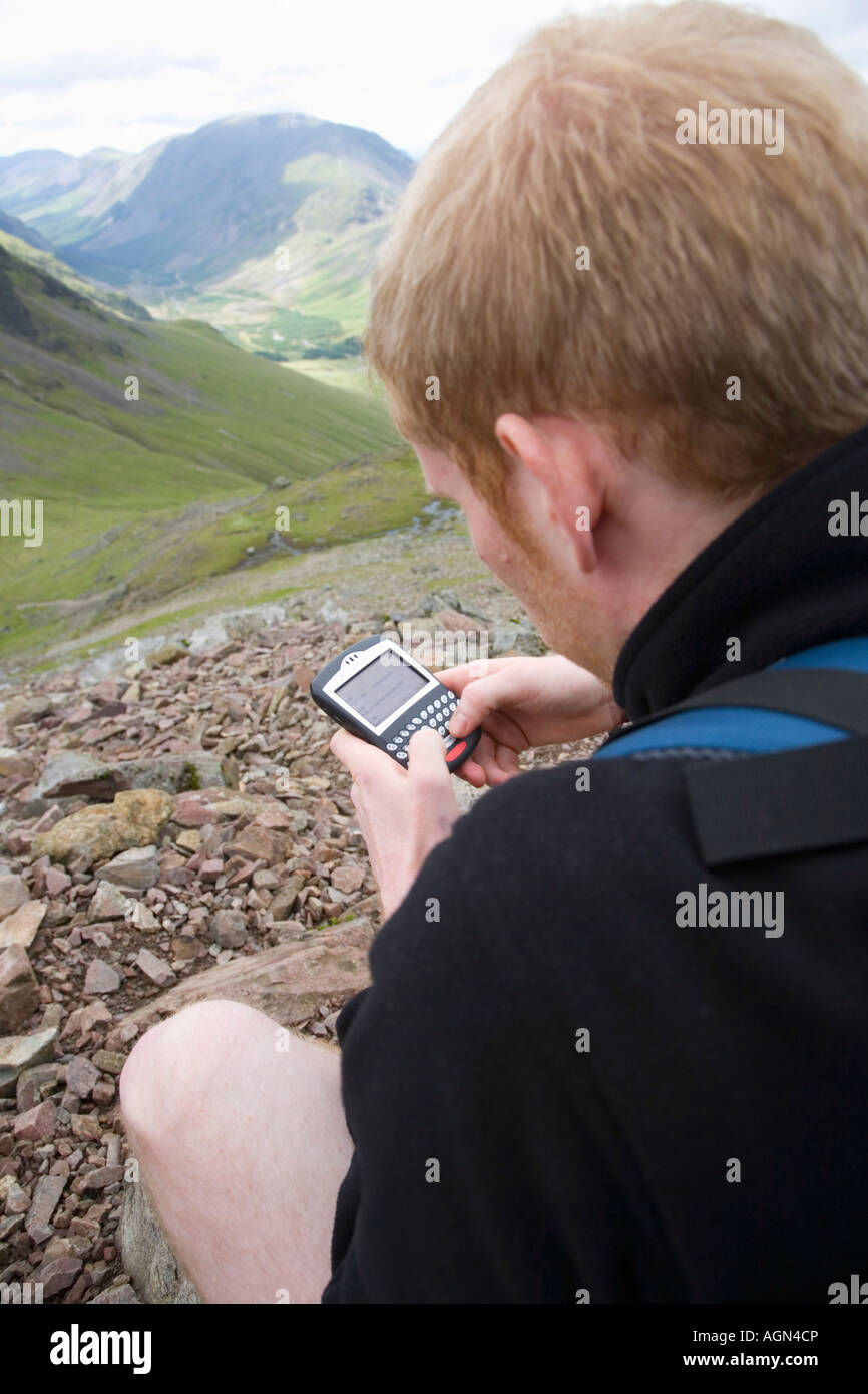 Male 25-35 using Blackberry in the Fells Lake District