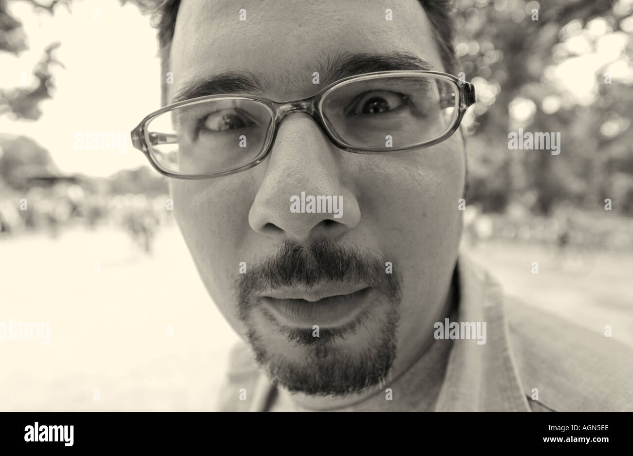 2d84ca3f0ef funny portrait of a man glasses moustache close up distord distorted nose  big look looking black