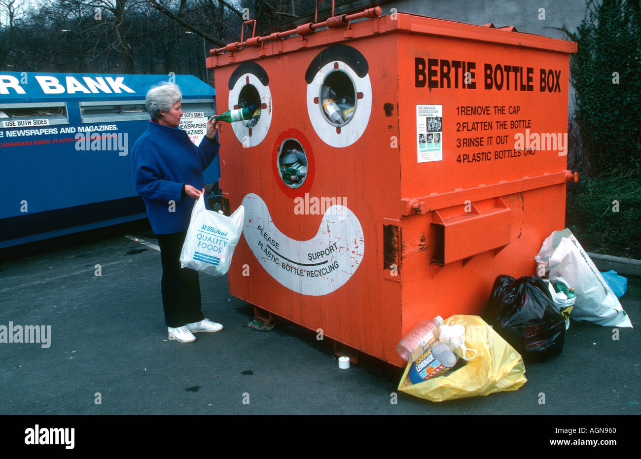 Bertie bottle bank plastic bottle recycling Tesco Car Park Leeds UK - Stock Image