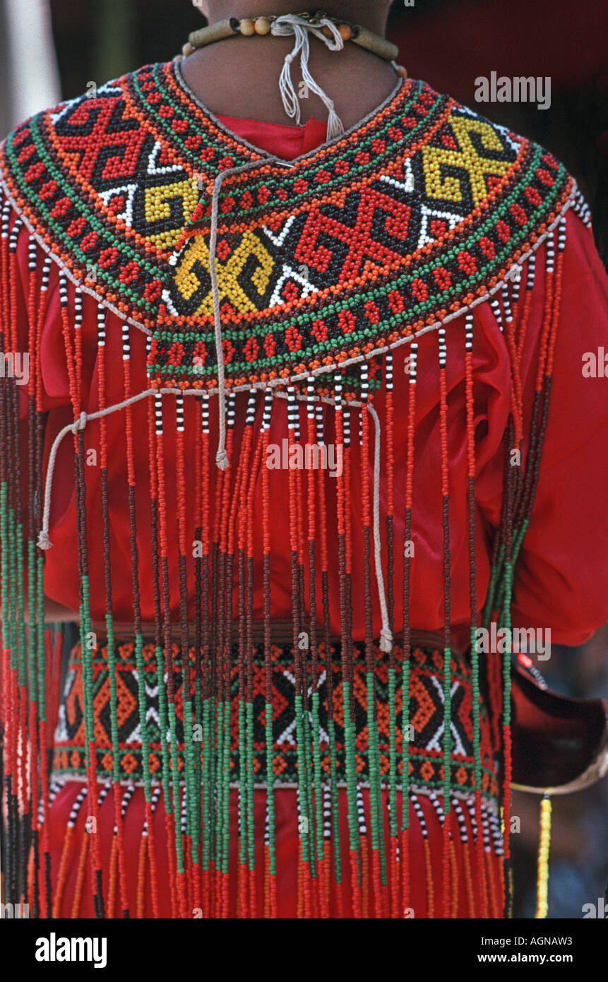 Tana Toraja Detail of a beaded ceremonial garment being worn by a Toraja girl at a ceremony to mark a wedding Sulawesi Indonesia - Stock Image