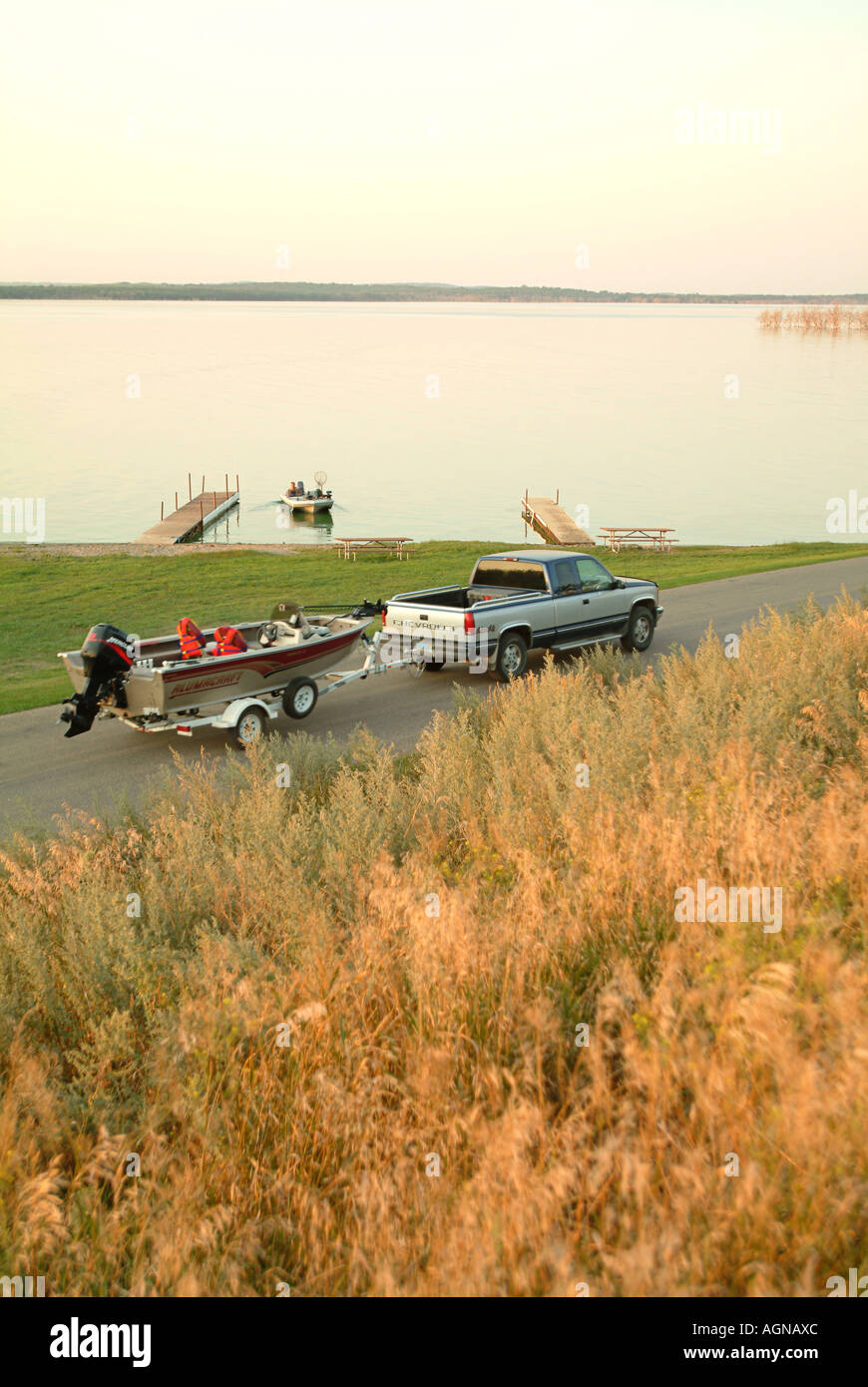 Truck pulling a fishing boat along Devils Lake North Dakota - Stock Image