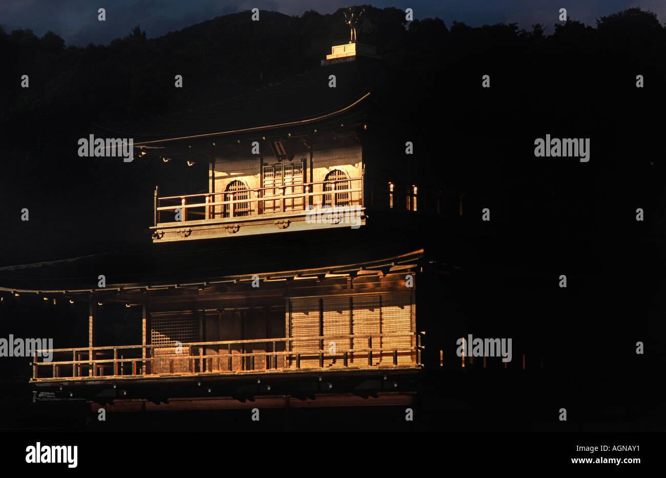Detail of Golden pavilion Kinkakuji Kyoto Japan The last rays of sunlight illuminate the gilded facade - Stock Image