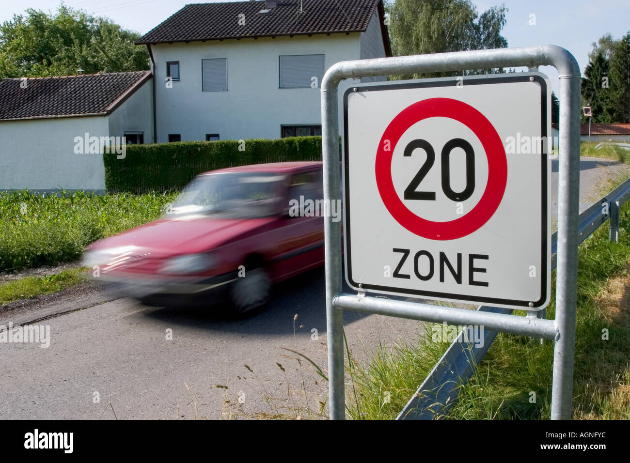 Markt Schwaben, GER, 26. June 2006 - A car passes a sign which marks the begin of a speed limited zone in Markt Stock Photo