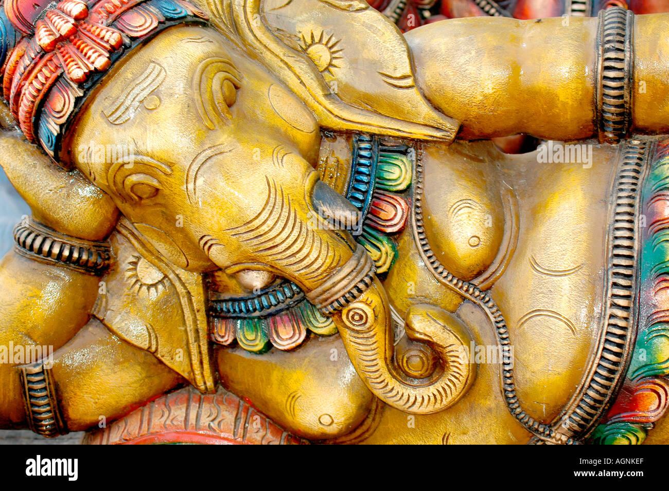 Lord Ganesha mythology Indian deity colorful Wooden Sculpture souvenir handicraft memento - Stock Image