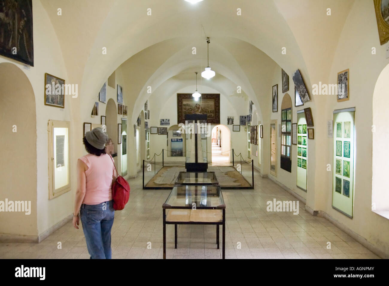 Israel Jerusalem the old city The Armenian Museum in the Armenian quarters Woman looking at the display - Stock Image